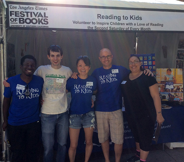 Volunteers at the Reading to Kids Festival of Books booth