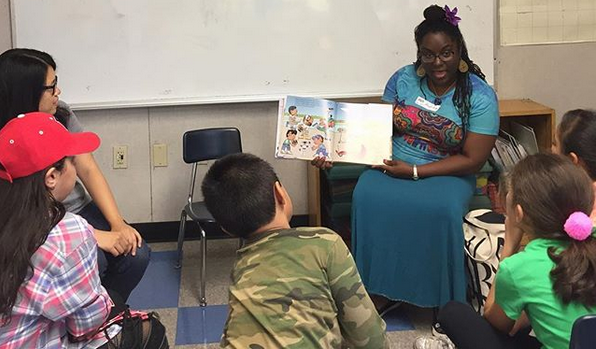 Andrea Loney reading to children