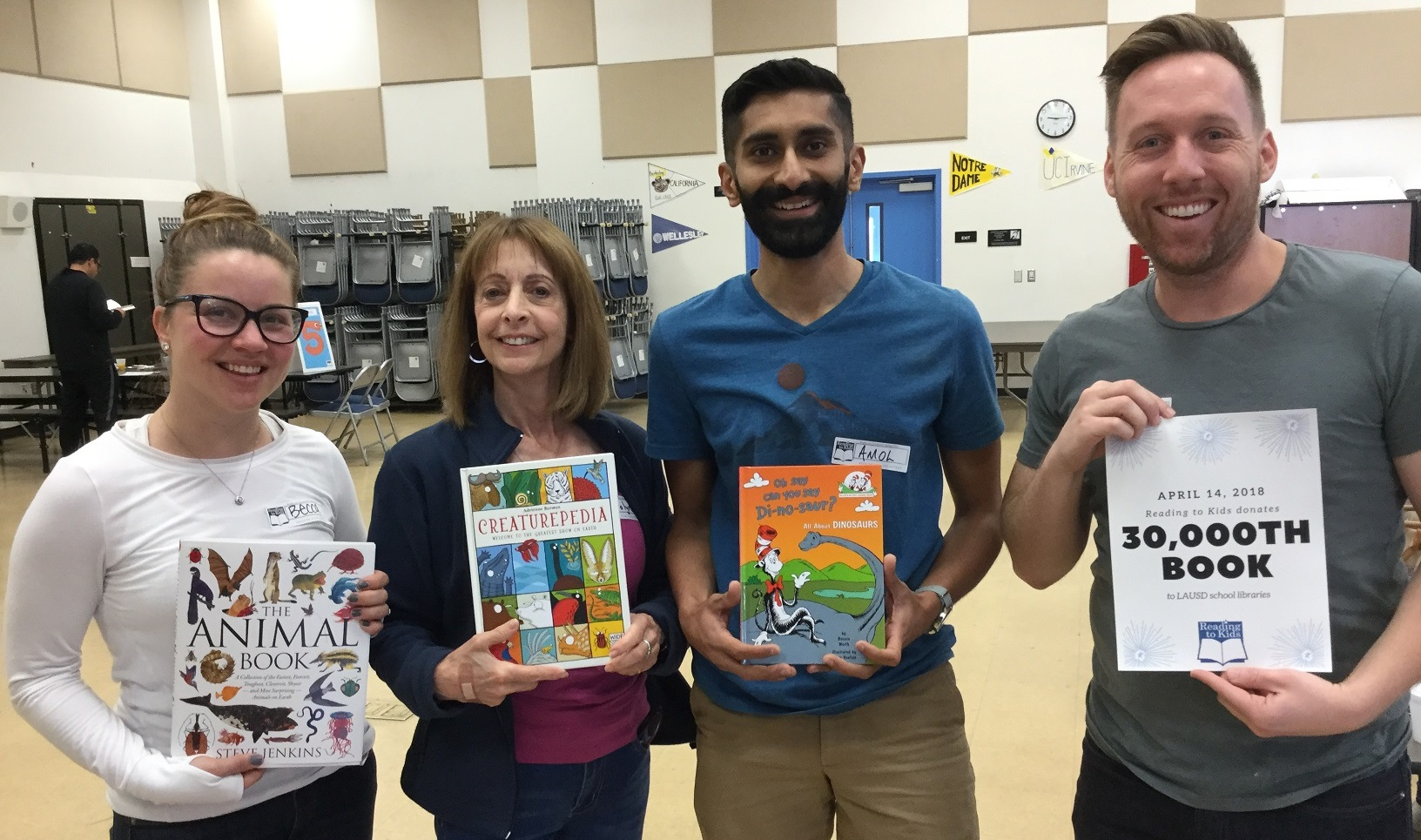 Volunteers with 30,0000th donated library book
