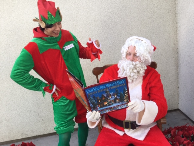 Santa and elf at MacArthur Park reading clubs