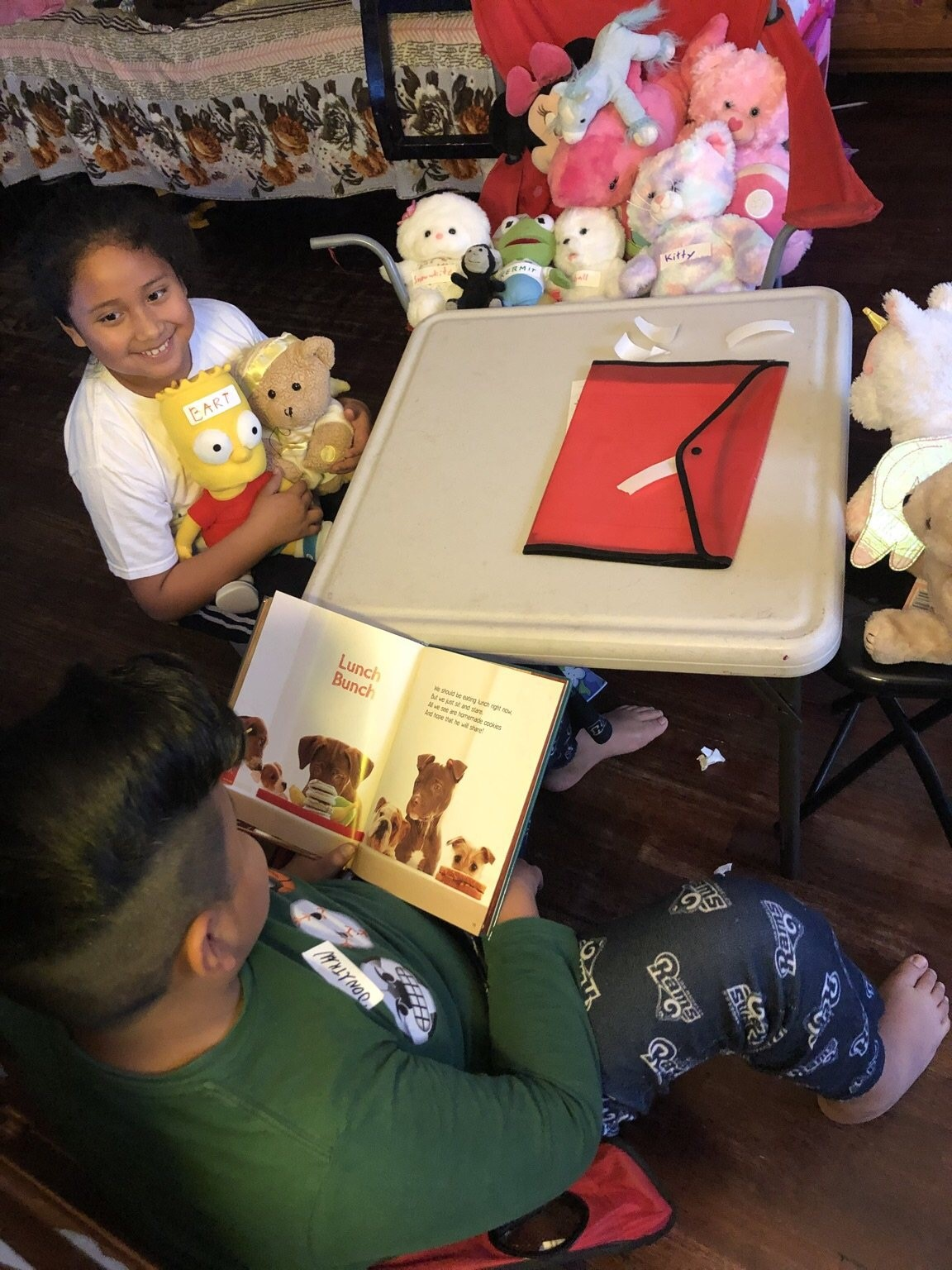 A brother and sister recreate a Reading to Kids reading club at home