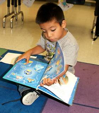 A boy reading at our reading clubs
