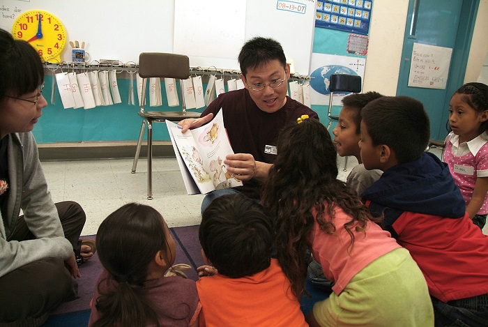Volunteers reading aloud to kids