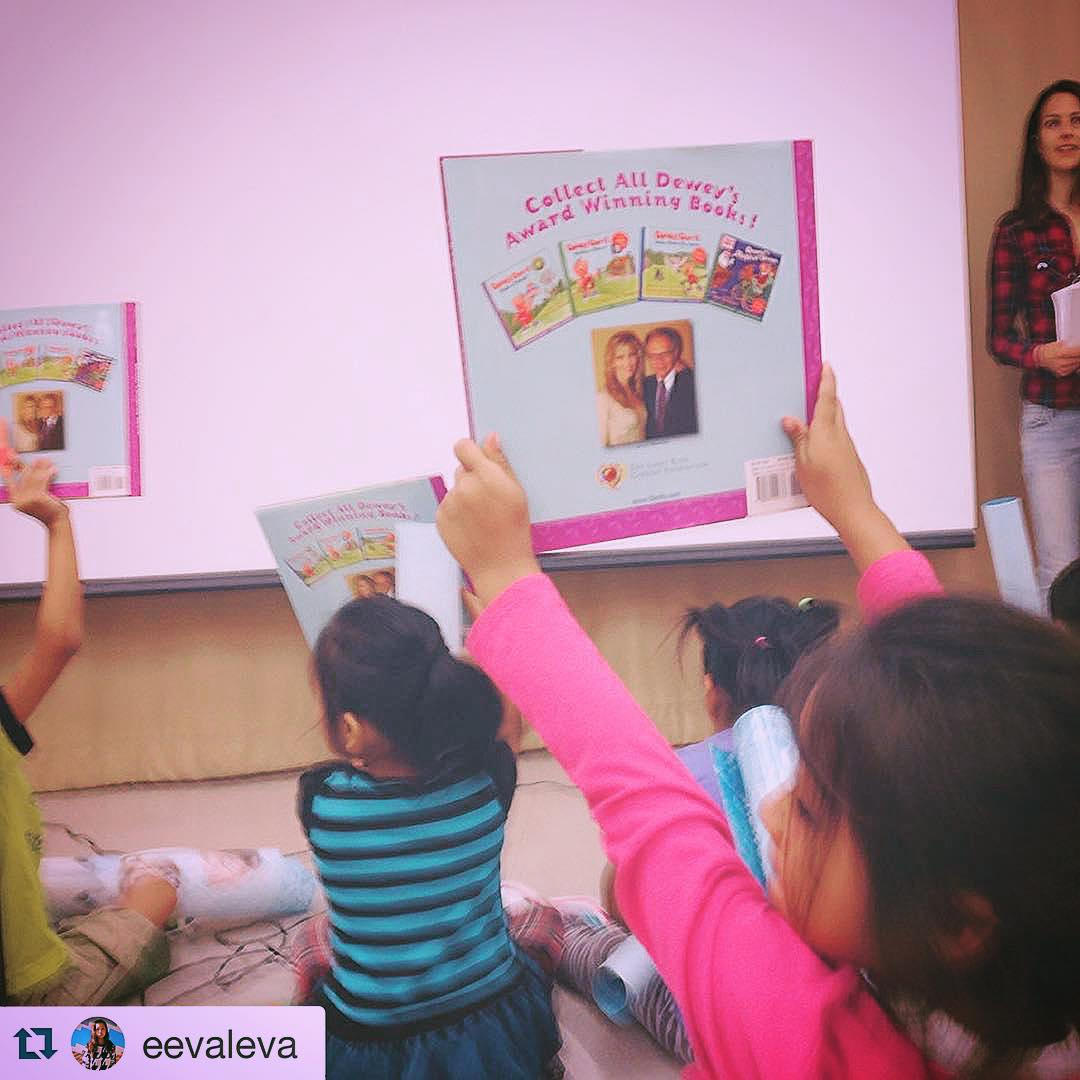 Kids with their books from Reading to Kids